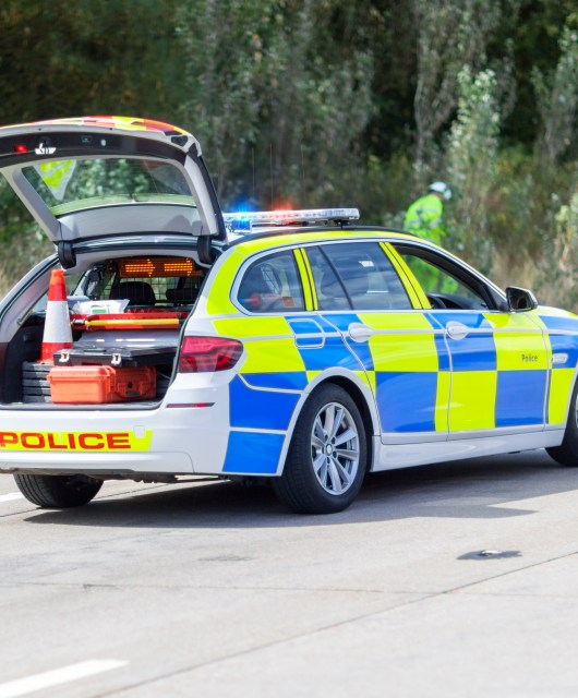 British police car at uk motorway accident or crime scene