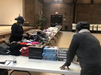 Lorraine Parker-Miller and Charlene Hursey sorting gifts for distribution