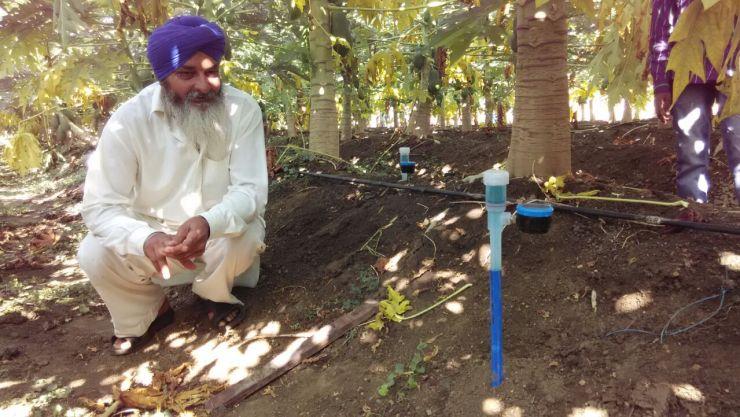 indian farmer using