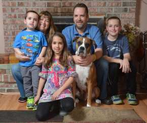 From left are Aidan,4, his mother Tara, sister Caitlin, 8, father Patrick, dog Trooper, and brother Ryan, 12.At the home of the Dunion family in Amity township Wednesday evening. Patrick and Tara Dunion's son Aidan, 4, has an inoperable brain stem tumor Diffuse Intrinsic Pontine Glioma (DIPG). Photo by Ben Hasty