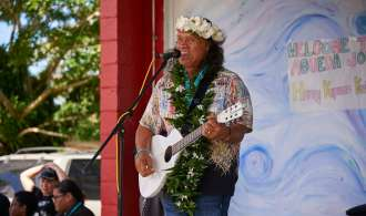Henry Kapono performs for AIJMS students