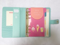 Has a pen loop, front pockets and complete with planner inserts