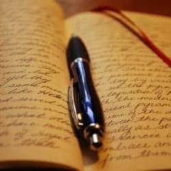 written journal and pen photo