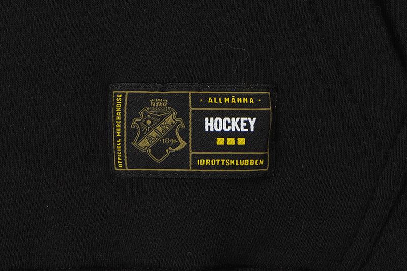 svart hoodie med aik hockey stockholm tryck