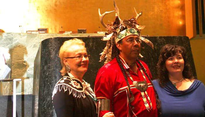 Tadodaho Sid Hill with the late Founder of the American Indian Law Alliance, Tonya Gonnella Frichner (Onondaga Nation) and current President and Executive Director of the American Indian Law Alliance, Betty Lyons (Onondaga Nation) at the opening of the Thirteenth Session of the United Nations Permanent Forum on Indigenous Issues (2014). Tadodaho Sid Hill, spiritual leader of the Haudenosaunee opens the annual session of the United Nations Permanent Forum on Indigenous Issues in New York City.