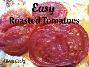 three slices of roasted tomatoes on a foil-lined cookie sheet.