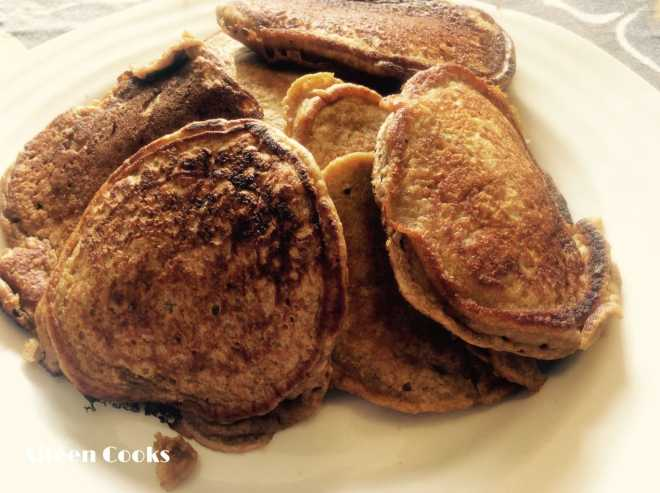 White plate piled high with healthy pumpkin pancakes.