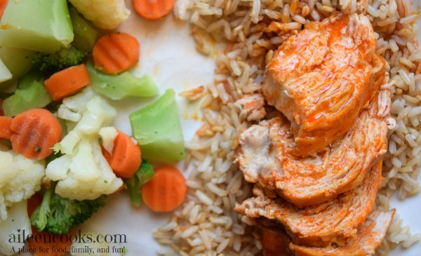 Easy and healthy crockpot buffalo chicken with just 4 ingredients make this slow cooker chicken dinner the perfect weeknight meal. Recipe from aileencooks.com