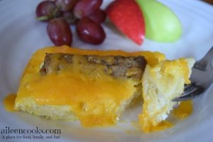 Egg & Sausage Breakfast Casserole made with turkey sausage and crescent rolls. Perfect Christmas morning breakfast or brunch recipe. Found on aileencooks.com.