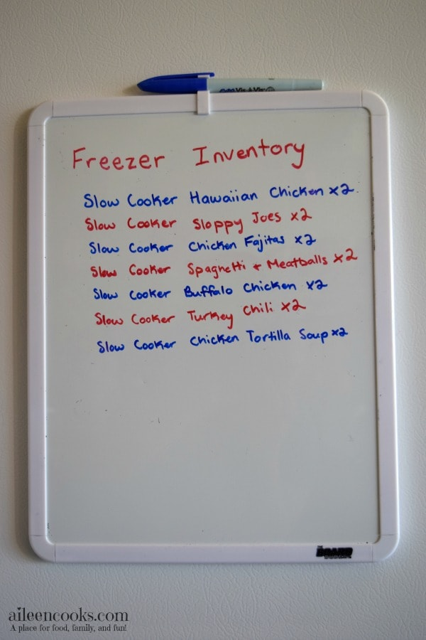 A white dry erase board with a list of crockpot freezer meals.