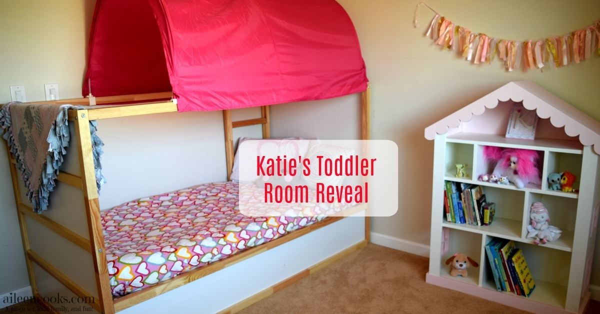 Inside our toddler girl room reveal featuring pink and grey colors, ikea kura bed, and dollhouse bookcase.