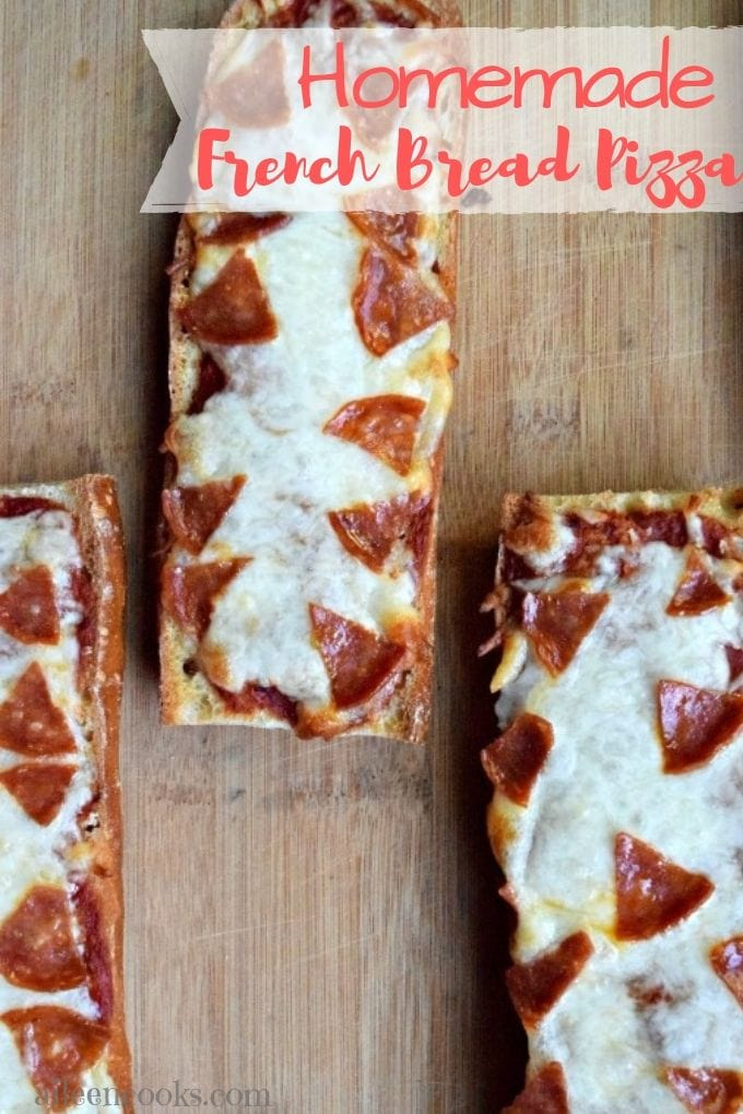 """Three French bread pizzas on a wooden cutting board with the words """"homemade French bread pizza"""""""