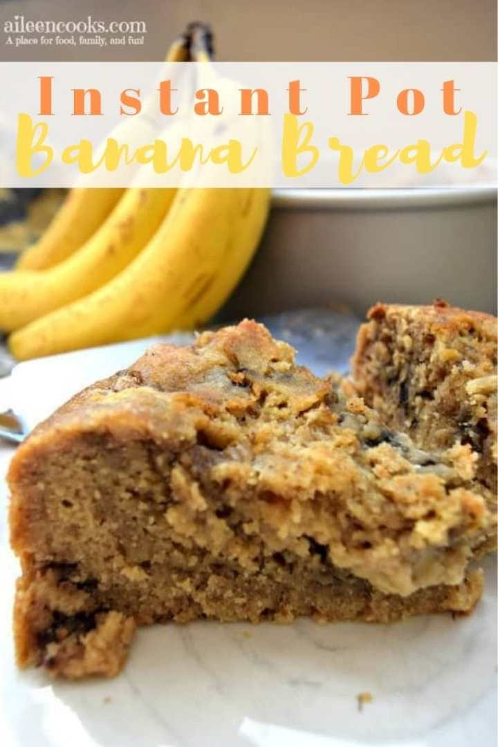 Two slices of instant pot banana bread on white plate with bananas in the background.