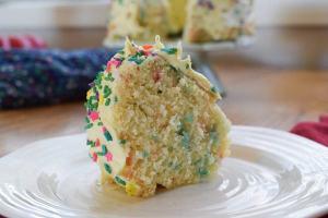 slice of instant pot cake with full bundt cake in background.
