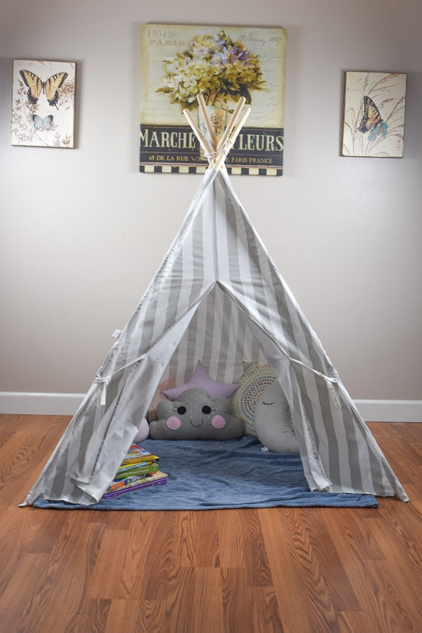 Reading nook teepee sitting inside a house with a white wall.