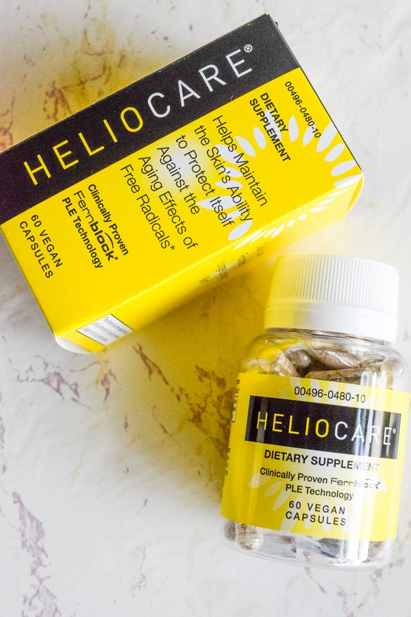 yellow bottle of heliocare supplement