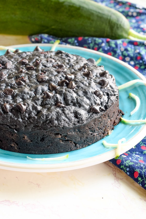 instant pot double chocolate zucchini bread on a blue plate