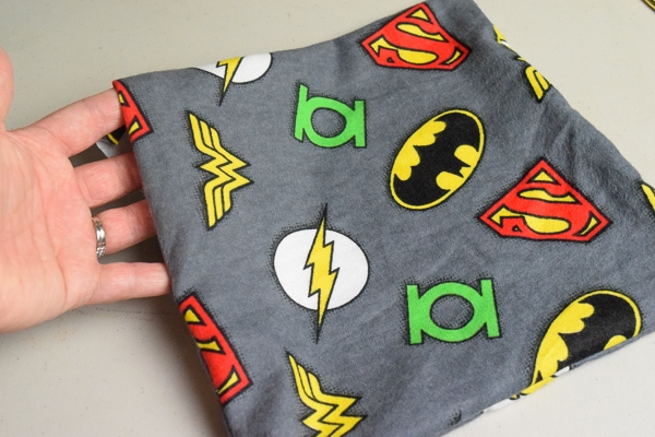 Superhero fabric sewn together and ready to attach the fabric tooth.