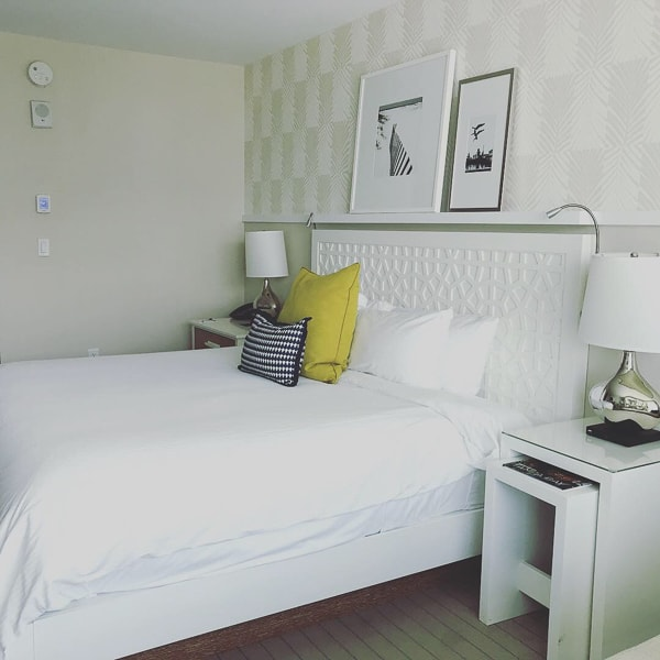 The bed at the Wyndham Grand Clearwater Beach had white linnens with grey and yellow throw pillows.