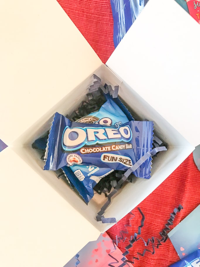 A white box with OREO cookie packs inside.