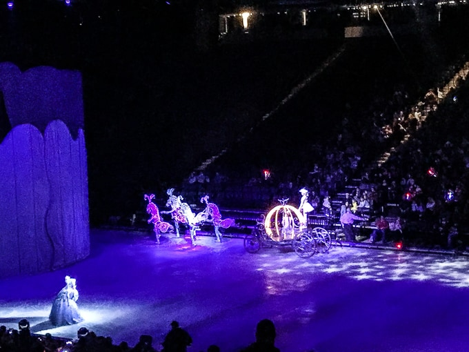 Cinderella in her carriage on the Disney on Ice Dare to Dream stage.