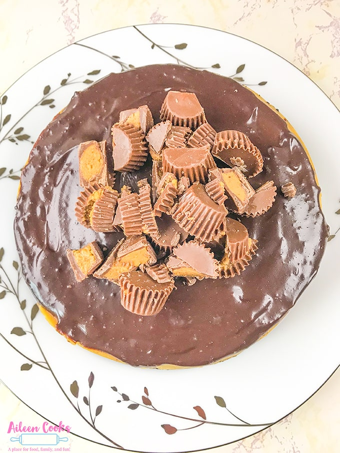 An overhead shot of instant pot Reese's cheesecake topped with peanut butter cups.