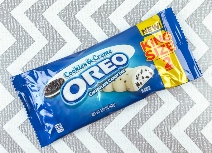 OREO cookies and creme candy bar on a white and grey zig zag background.