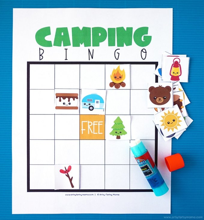 A camping bingo printable with a glue stick.
