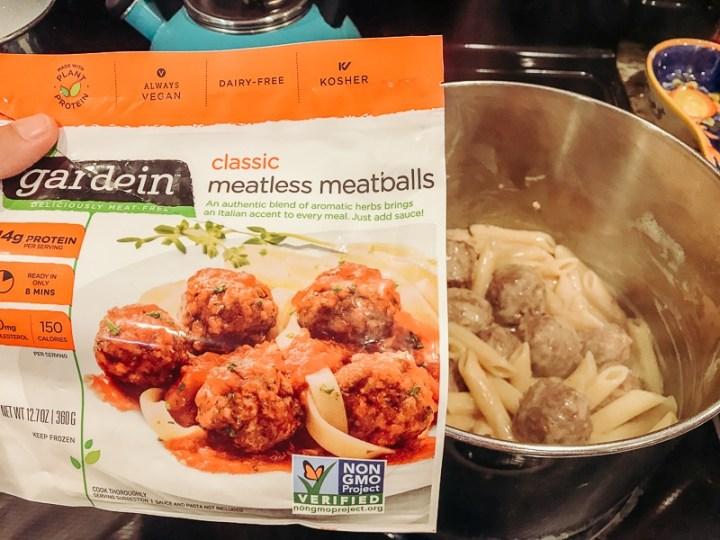 A bag of Gardien meatless meatballs in front of a pot.