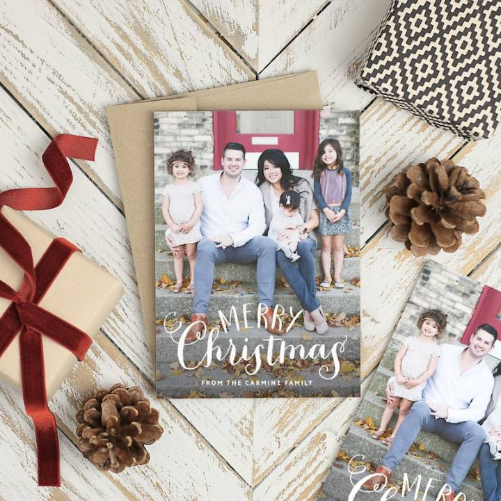 "A holiday card featuring a family and the words ""Merry Christmas""."