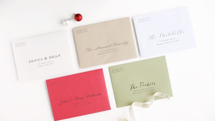 Colorful holiday card envelopes with addresses printed on them.