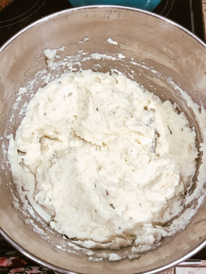 Keto cauliflower mashed potatoes freshly made and still in the pot.