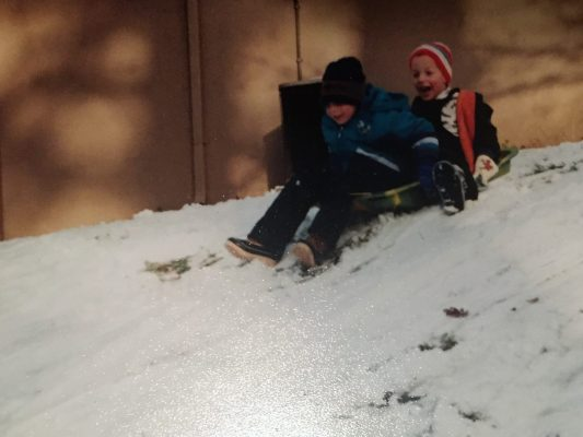 boys on sled