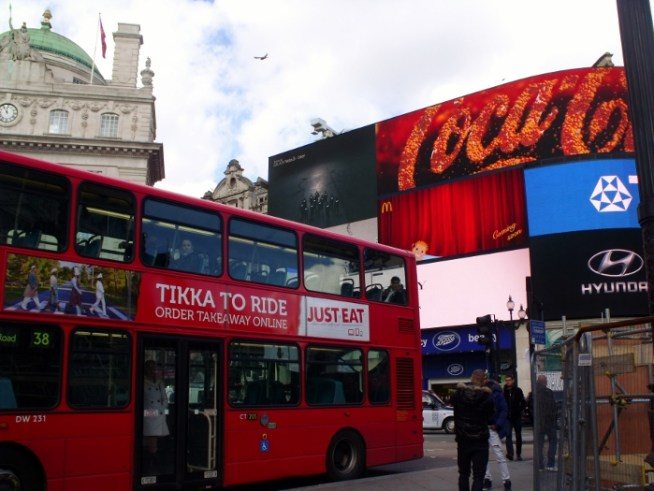 Big red bus in Piccadilly Circus, London. Ailish Sinclair | Author