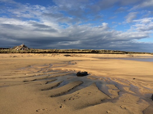 shadows at st combs beach in Aberdeenshire