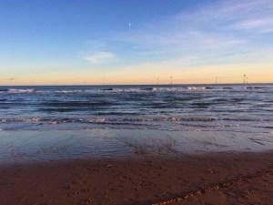 walking on the beach: wind turbines
