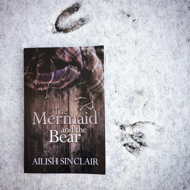 The Mermaid and the Bear by Ailish Sinclair in the snow by deer tracks
