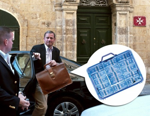roberts with suitcase of money