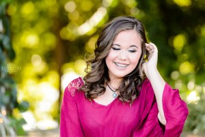 brown haired girl in garden for senior session at Tryphena's garden