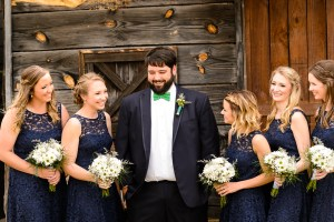 Middle Georgia Wedding, Plantation Farms wedding, bride and groom, wedding day, farm wedding, garden wedding, groom with bridesmaids in front of barn door laughing