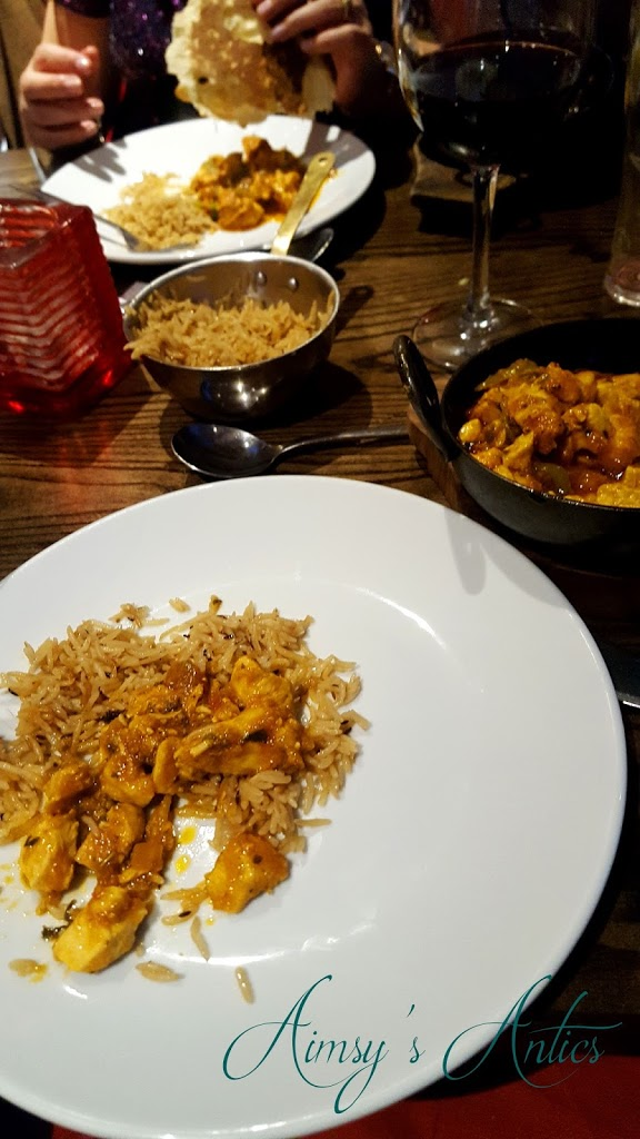 Meal - Chicken Kahari in a curry dish with rice and red wine.