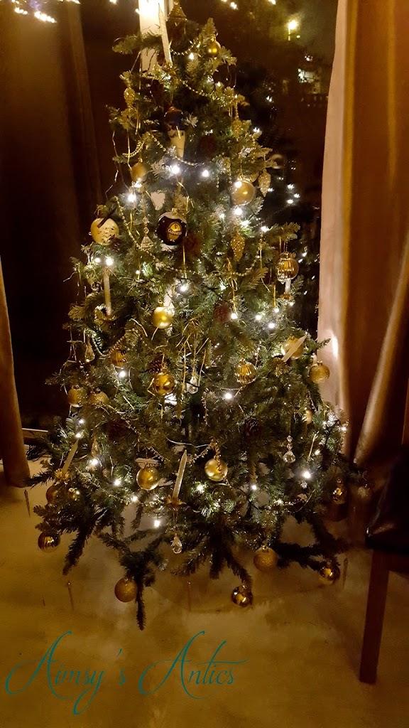 Christmas tree with lights, and christmas decorations.