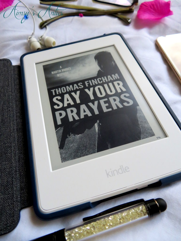 A kindle with 'Say your prayers' book cover displayed on it