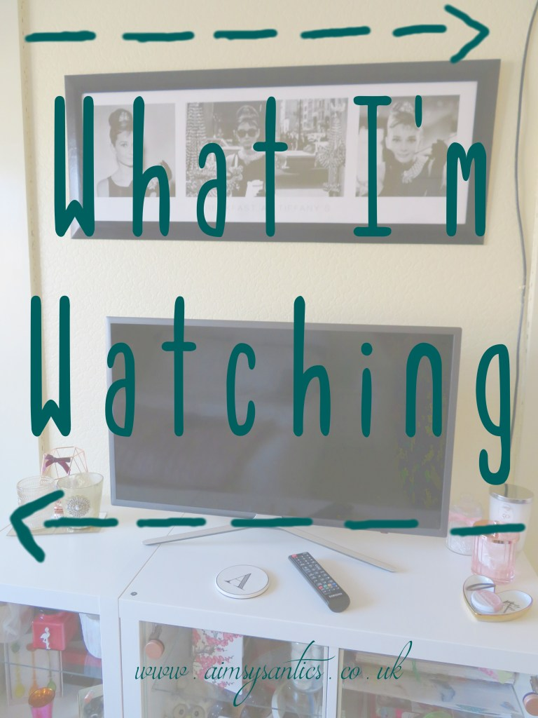 "Faded image of a TV on a shelving unit with the text overlay ""What I'm watching"""