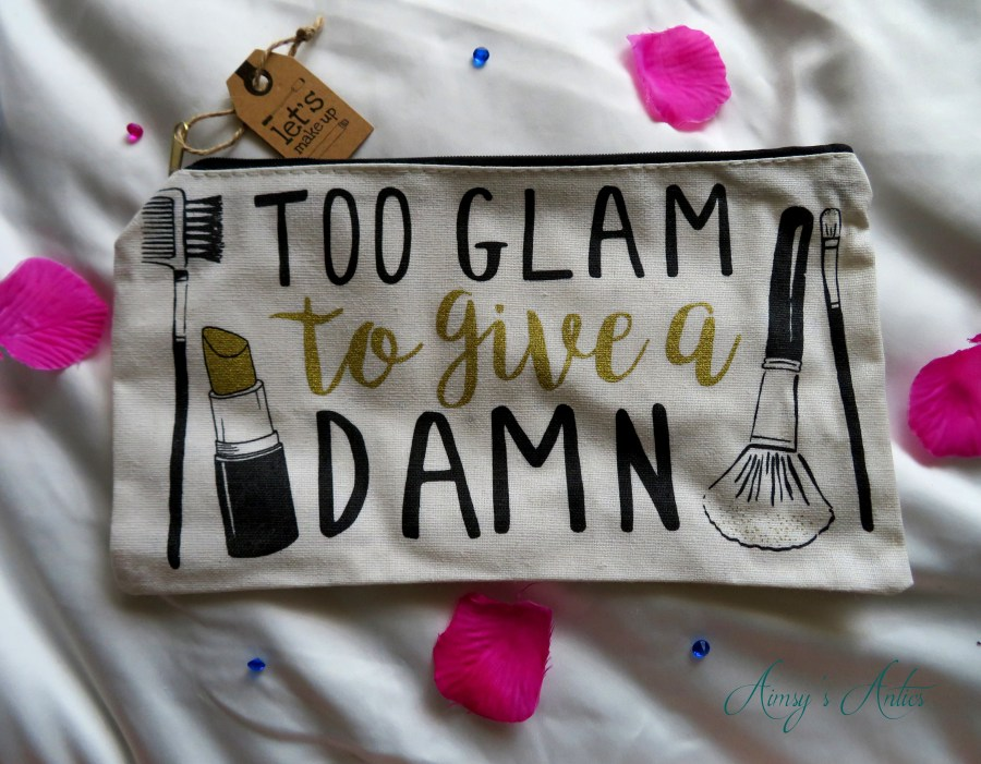 Makeup Bag 'too glam to give a damn' written on it