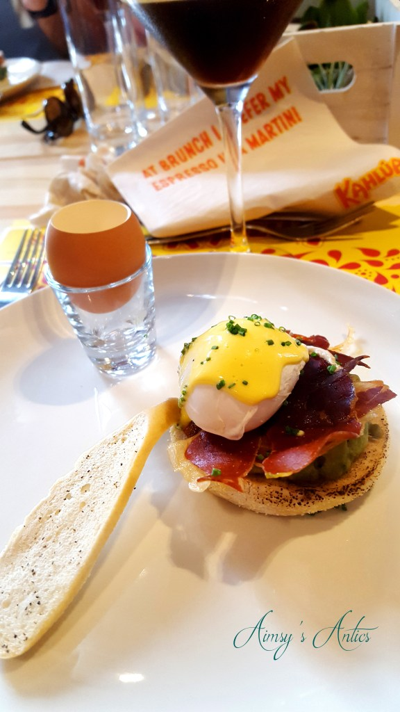Image of Smashed avocado and poached egg on english muffin with Kahlua cured ham