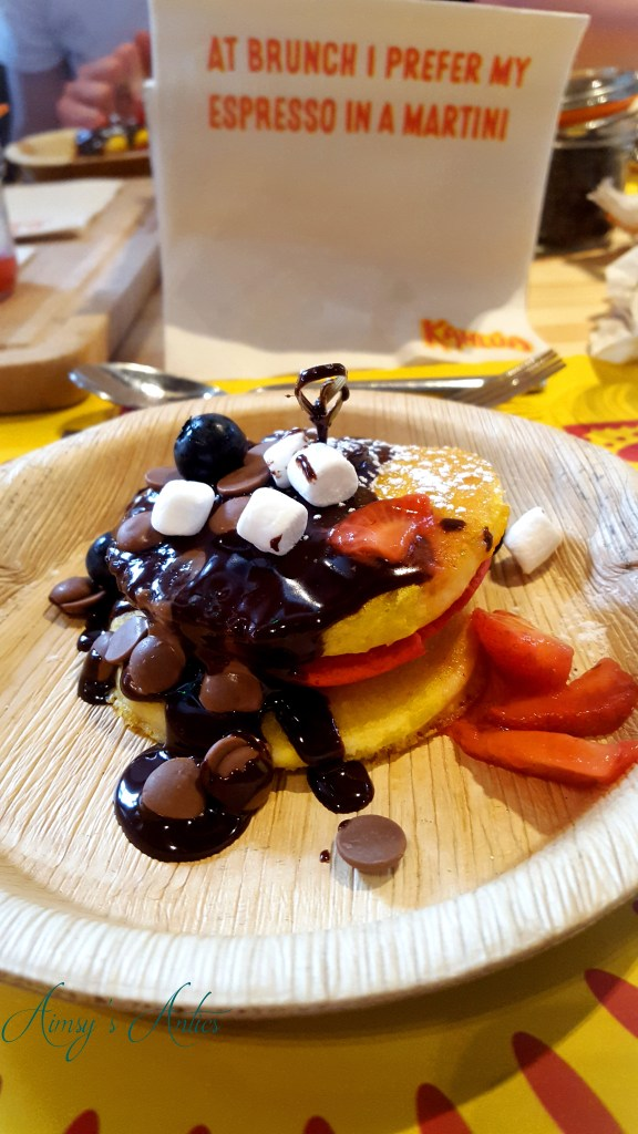 Image of Pancakes with chocolate sauce, chocolate buttons, marshmallows, strawberries and blueberries