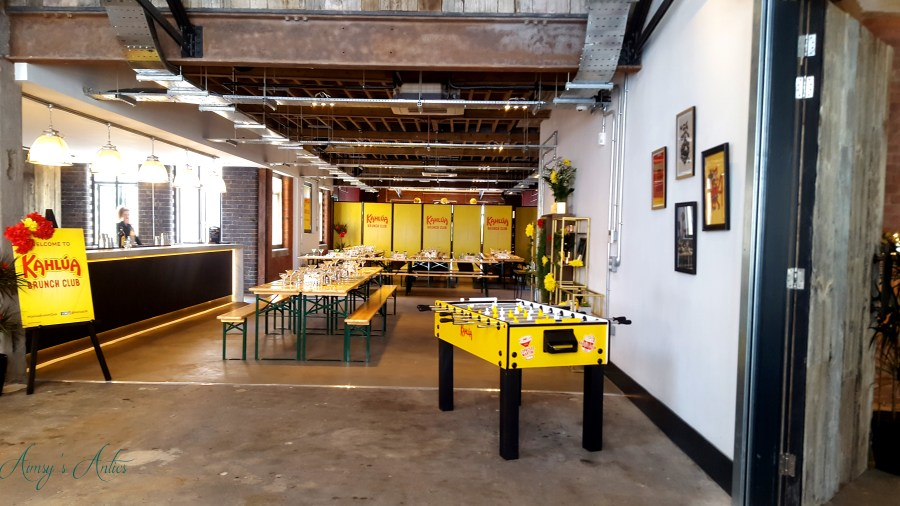 Image of the View of The Loft, including long tables and fuse ball table