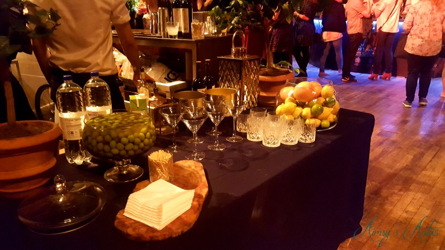 Image of Cocktail table with glasses and fruit decoration at Leeds Town hall at the cocktails in the city event