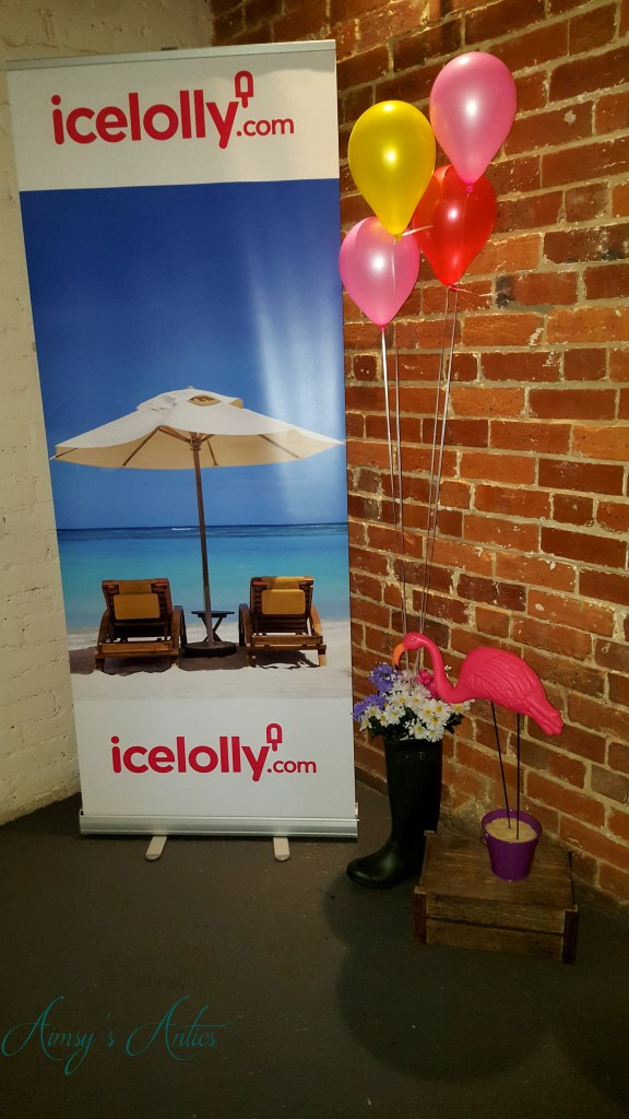 Blog at the beach event decor - Ice lolly holidays banner, balloons and a flamingo